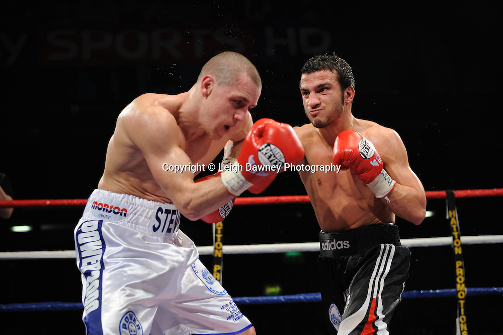 Ermano Fegatilli (black,white & red shorts) defeats Stephen Foster Jnr claiming the European Super Featherweight Title after 12 x 3min rounds. Venue: Premier Suite,Reebok Stadium, Bolton,UK. Saturday 26th February 2011. Hatton Promotions. Photo credit © Leigh Dawney.