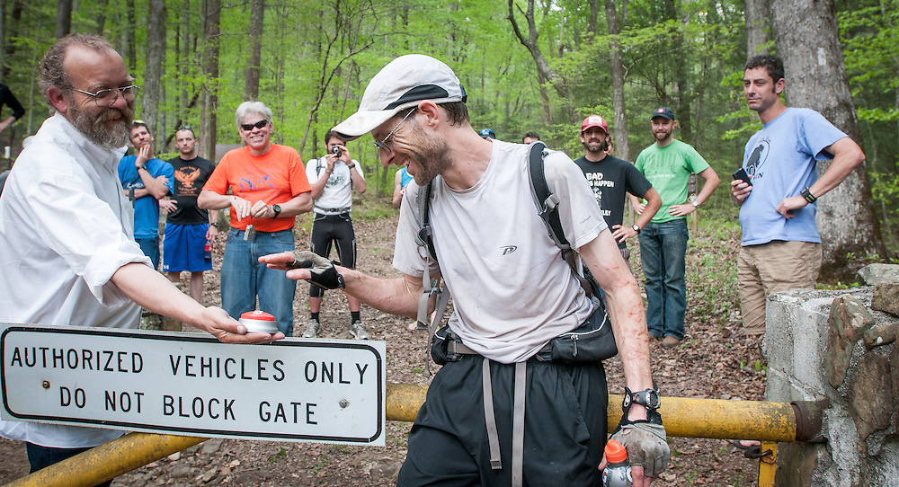 "Race Director Lazarus Lake (Gary Cantrell) offers Brett Maune the ""That Was Easy"" button after winning the 2012 Barkley Marathons. Maune set a new course record of 52:03:08."