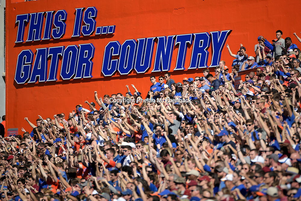 Florida fans cheer in the stands during the first half of an NCAA college football game against Florida State Saturday, Nov. 25, 2017, in Gainesville, Fla. (Photo by Phelan M. Ebenhack)