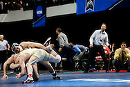 Wartburg's Eric Devos and Coe's Ryan Harrington grapple during the 174 pound bout at the NCAA Division III Wrestling Championship Semifinals at the U.S. Cellular Center in Cedar Rapids on Sat. Mar 12, 2016. Devos won the bout, advancing to the finals on Saturday  night. (Rebecca F. Miller/The Gazette)