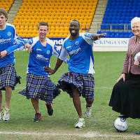 St Johnstone players Chris Millar, Gregory Tade and Murray Davidson pictured at McDiarmid Park this morning ahead of tomorrow's game against Inverness with Provost Liz Grant where they donned 'saints tartan' kilts to support the Perth 2013 Kilt Run which wil take place on Saturday 10th August 2013, the aim is to attact over 2000 kilt runners to break the world record.<br /> Picture by Graeme Hart.<br /> Copyright Perthshire Picture Agency<br /> Tel: 01738 623350  Mobile: 07990 594431