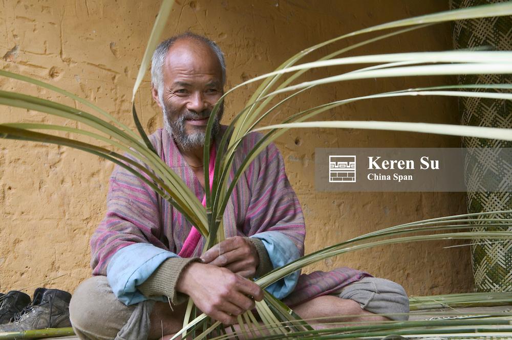 Man weaving bamboo mat, Trongsa, Bhutan
