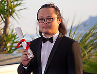 Director Qiu Yang, winner of the award for Best Short Film for A Gentle Night (Xiao Cheng Er Yue) at the Award Winner's Photocall at the 70th Cannes Film Festival Saturday 27th May 2017, Cannes, France. Photo credit: Doreen Kennedy