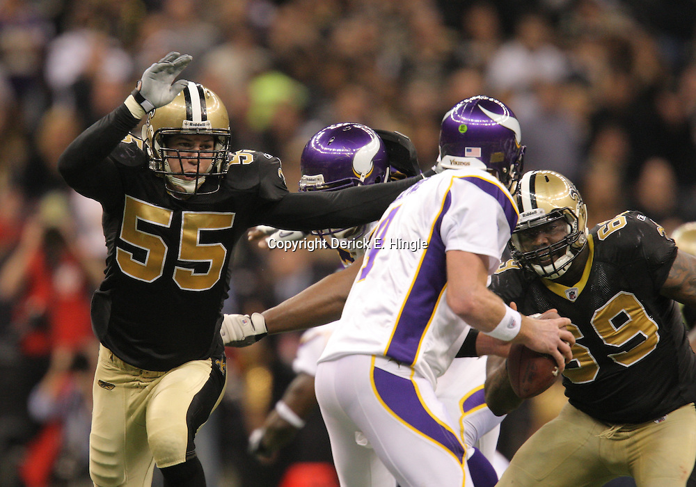 Jan 24, 2010; New Orleans, LA, USA; New Orleans Saints linebacker Scott Fujita (55) and defensive end Anthony Hargrove (69) pressure Minnesota Vikings quarterback Brett Favre (4) during a 31-28 overtime victory by the New Orleans Saints over the Minnesota Vikings in the 2010 NFC Championship game at the Louisiana Superdome. Mandatory Credit: Derick E. Hingle-US PRESSWIRE