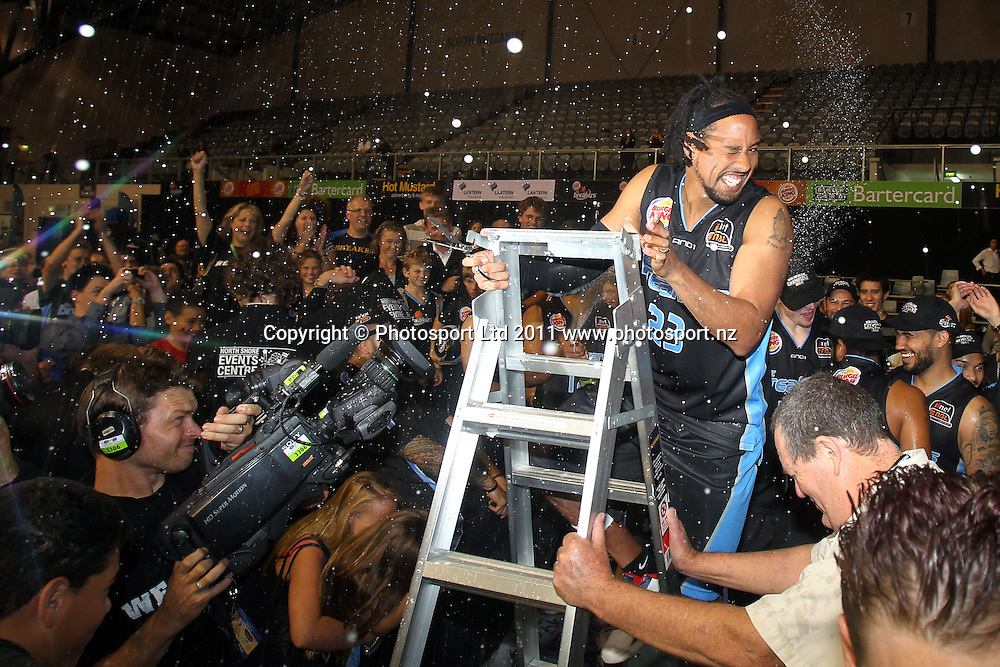 Breakers' CJ Bruton gets the champagne treatment. iinet ANBL, Grand Final Game 3, New Zealand Breakers vs Cairns Taipans, North Shore Events Centre, Auckland, New Zealand. Friday 29th April 2011. Photo: Anthony Au-Yeung / photosport.co.nz