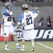 Ryan Young #27 of the Charlotte Hounds and John Haus #26 of the Charlotte Hounds celebrate a goal during the game at Harvard Stadium on May 17, 2014 in Boston, Massachuttes. (Photo by Elan Kawesch)
