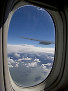 View from cabin through window of international airliner over Atlantic Ocean