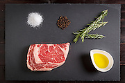 Rosemary Rib Eye Steak on slate. Photo By Tom Turner