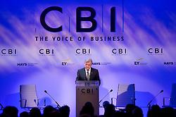 © London News Pictures. 04/11/2013 . London, UK.  The Confederation of British Industry (CBI) President Sir Michael Rake delivers a speech at the 2013 Confederation of British Industry (CBI) Conference, held at the Hilton Metropole in London. Photo credit : Ben Cawthra/LNP