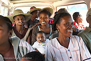 200, Ginot Razafindranaivo, male, 14 months old, UCL, before with mother Monica Ranorosoa join other patients who have never visited the city before to travel from the patient shelter to screening. <br /> <br /> Hospital Joseph Ravoahangy Andrianavalona.  Operation Smile's 2015 mission to Antananarivo - Madagascar. 10th -18th April 2015.<br /> <br /> (Operation Smile Photo - Zute Lightfoot)