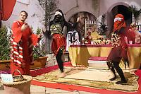 """E' giunto alla sesta edizione """"Il presepe vivente nel borgo antico"""". Migliaia di visitatori, infatti, ogni anno non perdono l'occasione di ammirare il suggestivo centro storico medievale, che diventa, con le accoglienti abitazioni, con le sue corti, i suoi caratteristici vicoli e le antiche viuzze, teatro magnifico e ideale per rappresentare l'antica Betlemme e per accompagnare il visitatore in un viaggio fra le numerose scene di vita quotidiana, appartenenti a un passato ormai lontano e che risvegliano con intensità le emozioni legate alla magia del Natale e, soprattutto alla nascita di Gesù Bambino. La scenografia naturale del borgo antico è ciò che maggiormente caratterizza il Presepe Vivente di Specchia, le cui strade, illuminate da originali fiaccole, guideranno i passi dei visitatori da Piazza degli Artisti, lungo via Ferrante Gonzaga, fino alle Mura di Ponente, per poi sbucare su Piazza del Popolo, dove i due principali palazzi, Palazzo Coluccia e il Protonobilissimo Palazzo Risolo, accoglieranno, rispettivamente, fra le loro antiche mura, la fastosità della corte di Erode e l'umile stalla in cui è venuto alla luce il Figlio di Dio. Al centro della grandiosa Piazza la focareddha, pira ardente di legna, darà calore ai volti e ai cuori dei visitatori.<br /> <br /> And ' now in its sixth edition , """" The nativity scene in the old town ."""" Thousands of visitors , in fact, every year they do not lose the opportunity to admire the charming medieval old town, which becomes, with cozy homes, with its courts , its quaint narrow streets and ancient alleyways , magnificent theater and ideal to represent the ' ancient Bethlehem and to accompany the visitor on a journey through the many scenes of everyday life , belonging to a distant past and with an intensity that awaken the emotions tied to the magic of Christmas , and especially the birth of Baby Jesus. The natural scenery of the old town is the most important feature of the Living Nativity Mirror , whose streets , lit """