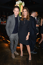 EDDIE REDMAYNE and CINDY CRAWFORD at the OMEGA VIP dinner hosted by Cindy Crawford and OMEGA President Mr. Stephen Urquhart held at aqua shard', Level 31, The Shard, 31 St Thomas Street, London, SE1 9RY on 10th December 2014.