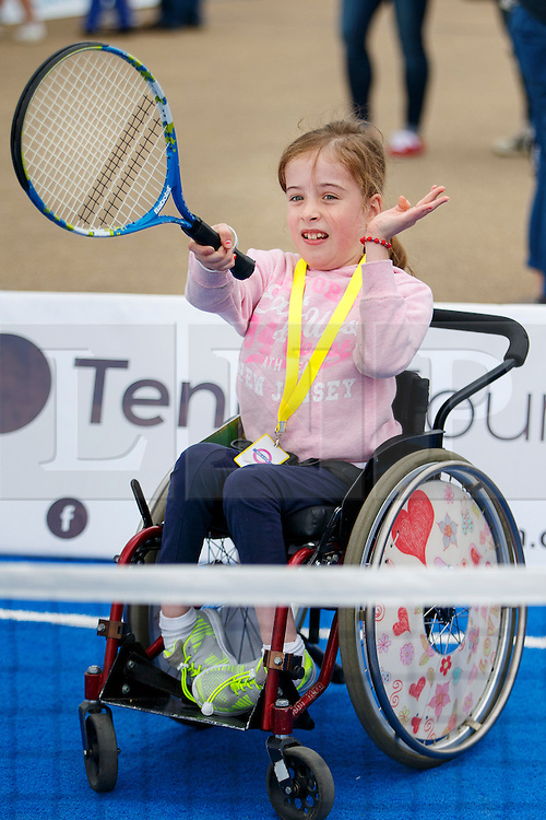 © Licensed to London News Pictures. 03/09/2016. LONDON, UK. Yasmine Hodkinson plays paralympics tennis to experience the disability sports at National Paralympic Day and Liberty Festival in Queen Elizabeth Olympic Park in London on Saturday 3 Spetember 2016. Photo credit : Tolga Akmen/LNP