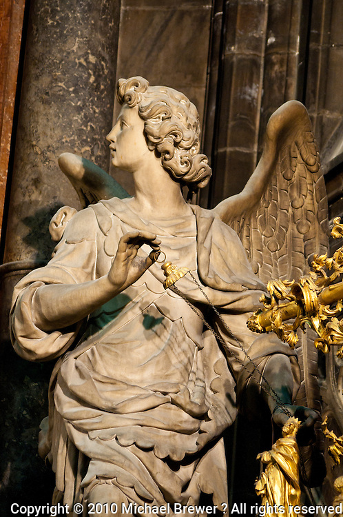 Milan, Italy, Duomo Cathedral interior - stone statue of an angel in profile.