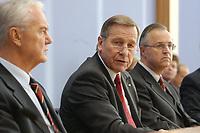 10 DEC 2002, BERLIN/GERMANY:<br /> Manfred Stolpe (L), SPD, Bundesbauminister, Wolfgang Clement (M), SPD, Bundeswirtschaftsminister, und Hans Eichel (R), SPD, Bundesfinanzminister, waehrend einer Pressekonferenz zur Schaffung einer Mittelstandsbank, Bundespressekonferenz<br /> IMAGE: 20021210-03-013