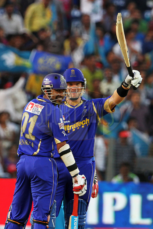Rajasthan Royals player Shane Watson raises his bat after scoring a fifty during match 52 of the Indian Premier League ( IPL) 2012  between The Pune Warriors India and the Rajasthan Royals held at the Subrata Roy Sahara Stadium, Pune on the 8th May 2012..Photo by Vipin Pawar/IPL/SPORTZPICS