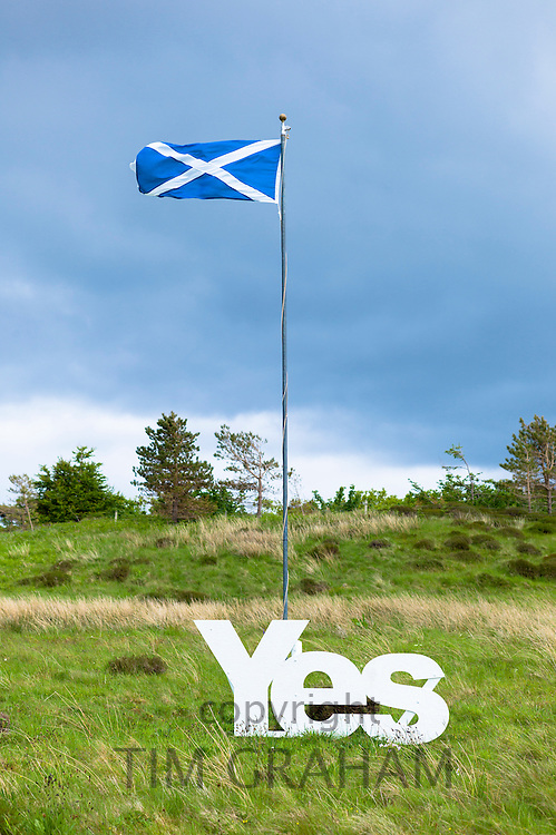 The Saltire national flag of St Andrew flying as Scottish Referendum Independence Debate campaign and lobbying urges voters to give a YES vote for a separate nation for Scotland