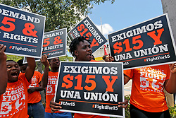 May 23, 2019 - Fort Lauderdale, FL, USA - A group of people gather together in support to McDonald's workers strike as part of a nationwide Fight for a $15 minimum wage movement at the McDonald's in Fort Lauderdale, Fla. on Thursday, May 23, 2019. (Credit Image: © TNS via ZUMA Wire)