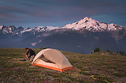 Backcountry camp high on Miner's Ridge, Glacier Peak in the Distance, Glacier Peak Wilderness North Cascades Washington.<br /> <br /> Glacier Peak (10,541&prime;) or Dakobed is the most isolated of the five major stratovolcanoes of the Cascade Volcanic Arc.