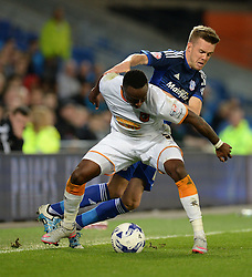 Cardiff City's Craig Noone Battles for the ball with Hull City's Moses Odubajo - Mandatory byline: Alex James/JMP - 07966386802 - 15/09/2015 - FOOTBALL - Cardiff City Stadium -Cardiff,Wales - Cardiff City v Hull City - Sky Bet Championship