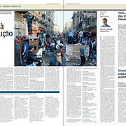 "Tearsheet (Feature story) of ""Egipto volta a revolucao"" published in Expresso"