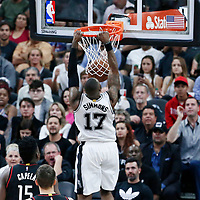 03 May 2017: San Antonio Spurs guard Jonathon Simmons (17) dunks the ball during the San Antonio Spurs 121-96 victory over the Houston Rockets, in game 2 of the Western Conference Semi Finals, at the AT&T Center, San Antonio, Texas, USA.