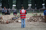 A Red Crescent worker takes a moment to pray and show her respect to the victims of Soma's coal mining incident.