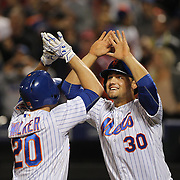 NEW YORK, NEW YORK - APRIL 25: Michael Conforto #30 of the New York Mets reacts at home plate as he congratulates Neil Walker #20 of the New York Mets after his two run home run in the seventh inning gave the Mets a 5-3 win during the New York Mets Vs Cincinnati Reds MLB regular season game at Citi Field on April 25, 2016 in New York City. (Photo by Tim Clayton/Corbis via Getty Images)
