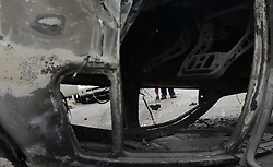 A man collects valuables besides a burnt vehicle at the site of xenophobic attacks in Johannesburg Town, South Africa, on April 17, 2015. South African police on Friday fired rubber bullets to disperse rioters in central Johannesburg, a fresh hotbed of xenophobia violence. The current spate of xenophobic violence mainly affects Durban and Johannesburg. According to official figures, five people have been killed and thousands of immigrants displaced. EXPA Pictures © 2015, PhotoCredit: EXPA/ Photoshot/ Zhai Jianlan<br /> <br /> *****ATTENTION - for AUT, SLO, CRO, SRB, BIH, MAZ only*****