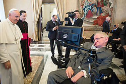 March 13, 2018 - FILE - STEPHEN HAWKING has died due to amyotrophic lateral sclerosis, a progressive neurodegenerative, he was 76. The British theoretical physicist was known for his groundbreaking work with black holes and relativity, and was the author of several popular science books including A Brief History of Time. PICTURED: November 28, 2016 - Vatican City, VATICAN - Pope Francis greets physicist Stephen Hawking during an audience with participants at a plenary session of the Pontifical Academy of Sciences, at the Vatican, Monday, November 28, 2016. (Credit Image: © Prensa Internacional via ZUMA Wire)