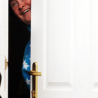 After becoming an overnight  sensation on Britain's Got Talent, the media interest continues on Susan Boyle...Her PR minder returned to Susan's house today with a mystery woman. ..Pic shows Susan Boyle peeking out from behind her door inviting her PR agent and the mystery woman inside.