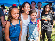 03 JULY 2019 - WEST DES MOINES, IOWA: US Senator KAMALA HARRIS, right, (D-CA)  poses for selfies with girls at the West Des Moines Democrats' annual 4th of July Picnic. Senator Harris attended the picnic to support her bid to be the Democratic nominee for the US presidency in 2020. Iowa hosts the first presidential selection event of the 2020 election cycle. The Iowa Caucuses are scheduled for Feb. 3, 2020.        PHOTO BY JACK KURTZ