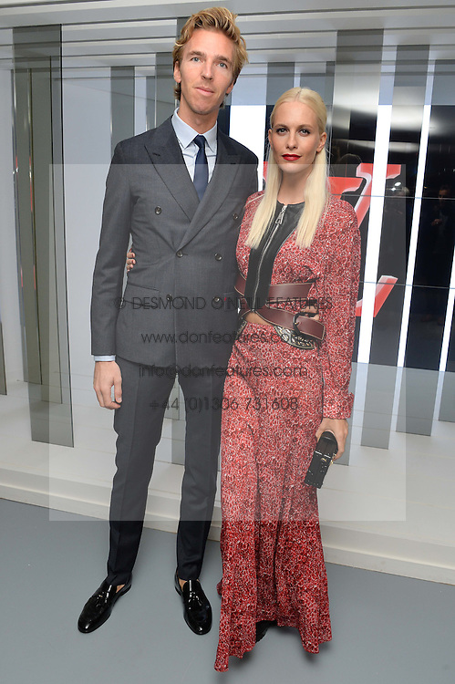 POPPY DELEVINGNE and JAMES COOK at the Louis Vuitton Series 3 VIP Launch held at 180 Strand, London on 20th September 2015.