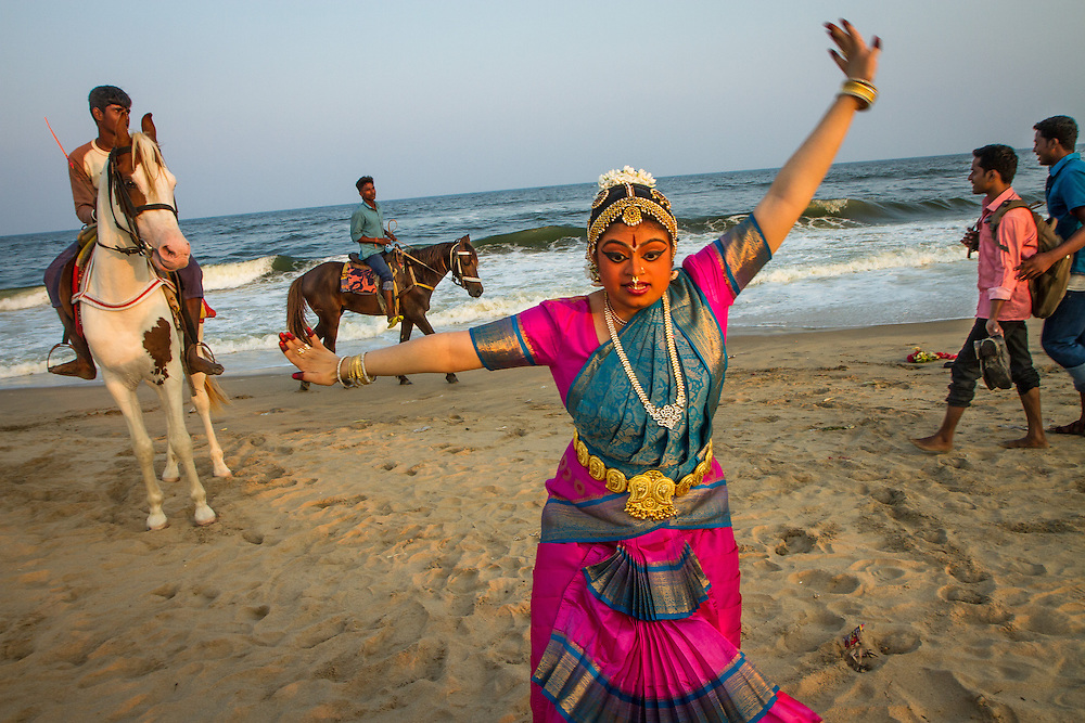 Chennai, India: Thought to be the first Indian American woman with Down syndrome in the United States to complete an arangetram (a public dance performance after years of formal study), Hema Ramaswamy, 24, traveled from her home in New Jersey to Chennai, India, to give a performance to an audience of special needs children. Afterwards, she posed for pictures at the Besant Nagar Beach.