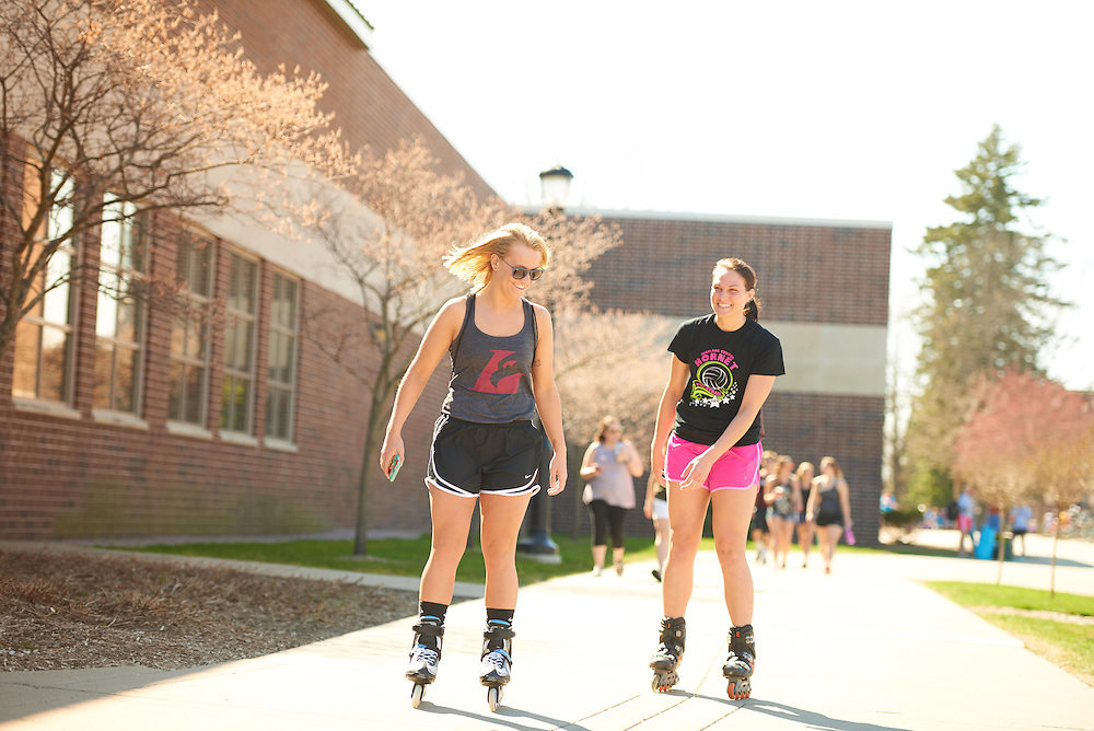 Activity; Socializing; Smiling; Relaxing; Playing; Buildings; Recreational Eagle Center Rec; Location; Outside; Objects; Logo; Eagle L; People; Woman Women; Student Students; Spring; April; Time/Weather; sunny; Type of Photography; Candid; Favorite; UWL UW-L UW-La Crosse University of Wisconsin-La Crosse; Rollerblading