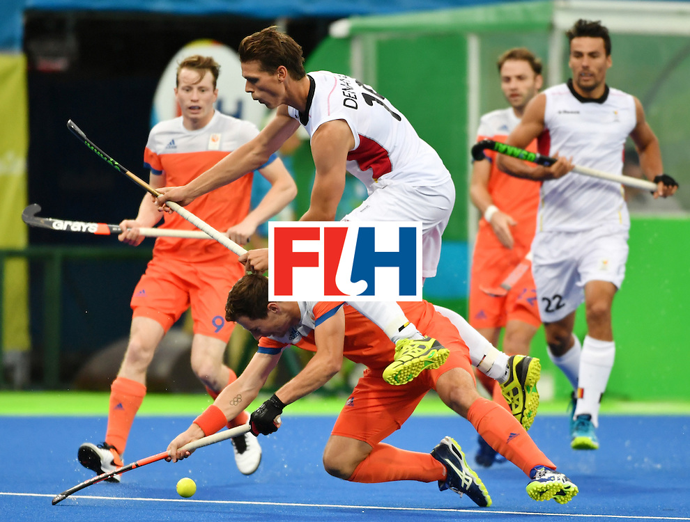 Belgium's Felix Denayer (top) jumps over Netherland's Sander Baart during the men's semifinal field hockey Belgium vs Netherlands match of the Rio 2016 Olympics Games at the Olympic Hockey Centre in Rio de Janeiro on August 16, 2016. / AFP / Pascal GUYOT        (Photo credit should read PASCAL GUYOT/AFP/Getty Images)