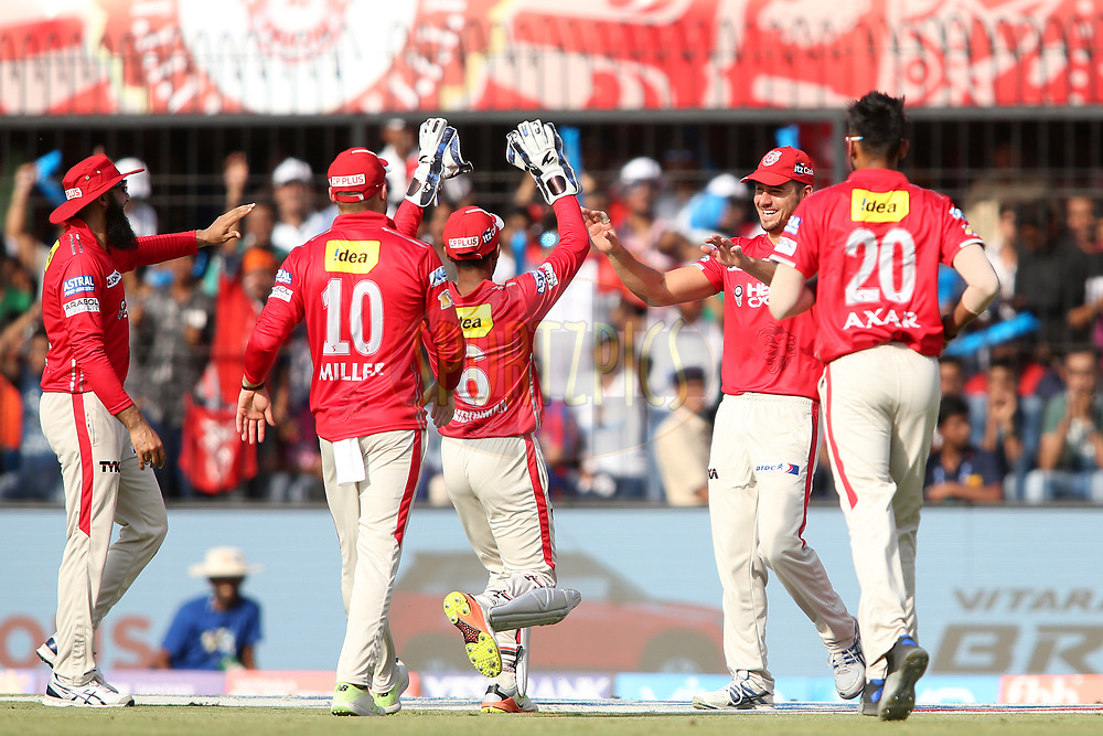 Marcus Stoinis of Kings XI Punjab is congratulated by Wriddhiman Saha of Kings XI Punjab for taking the catch to get Ajinkya Rahane of Rising Pune Supergiant wicket during match 4 of the Vivo 2017 Indian Premier League between the Kings XI Punjab and the Rising Pune Supergiant held at the Holkar Cricket Stadium in Indore, India on the 8th April 2017<br /> <br /> Photo by Shaun Roy - IPL - Sportzpics