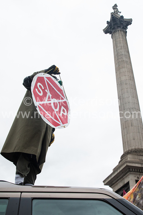 London, UK. 7 October, 2019. Climate activists from Extinction Rebellion use a Land Rover pulling a trailer to block Trafalgar Square on the first day of International Rebellion protests to demand a government declaration of a climate and ecological emergency, a commitment to halting biodiversity loss and net zero carbon emissions by 2025 and for the government to create and be led by the decisions of a Citizens' Assembly on climate and ecological justice.
