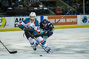 KELOWNA, CANADA - APRIL 25:  Dillon Dube #19 of the Kelowna Rockets, Scott Eansor #8 of the Seattle Thunderbirds at the Kelowna Rockets game on April 25, 2017 at Prospera Place in Kelowna, British Columbia, Canada.  (Photo By Cindy Rogers/Nyasa Photography,  *** Local Caption ***
