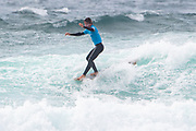 Benoit Carpentier 'hangs five' during the Boardmasters Longboard Pro at Fistral Beach, Newquay, Cornwall, United Kingdom on 10 August 2019.