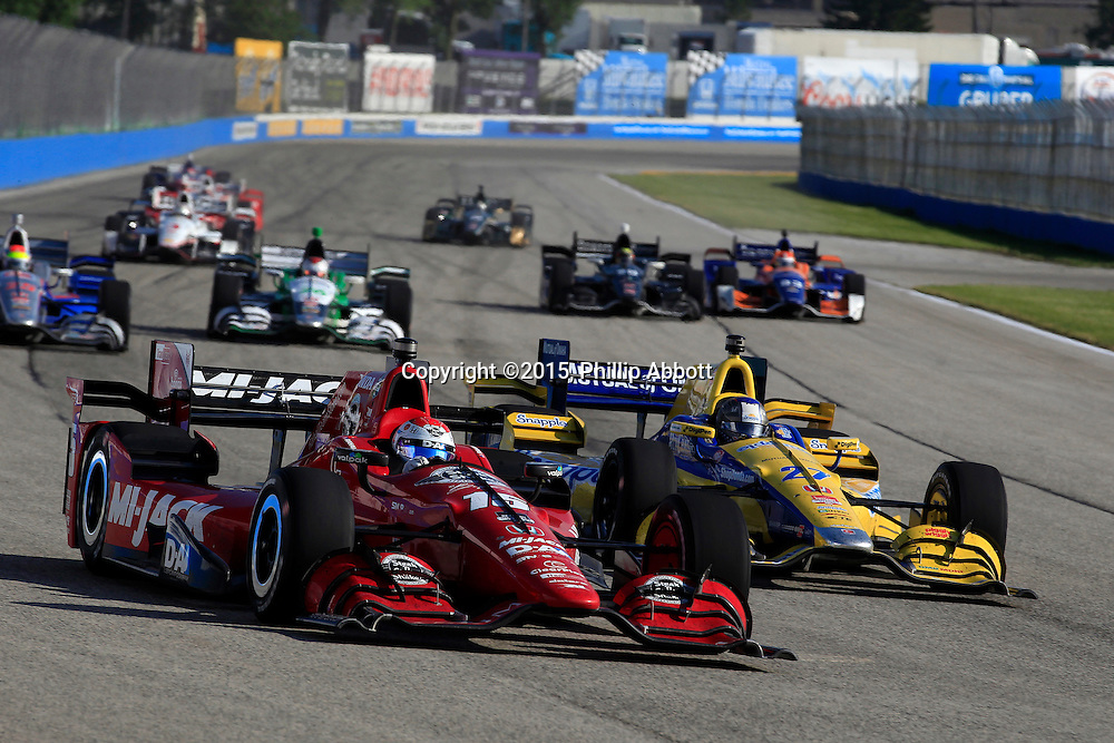 11-12 July, 2015, West Allis, Wisconsin USA<br /> Graham Rahal passes Marco Andretti<br /> &copy;2015, Phillip Abbott<br /> LAT Photo USA
