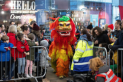 © Licensed to London News Pictures . 09/02/2019. Manchester , UK . Two men dressed as a lion perform a lion dance on Market Street in Manchester City Centre during Chinese New Year Celebrations in the city . Photo credit : Joel Goodman/LNP