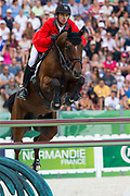 Steve Guerdat - Nino des Buissonnets<br /> Alltech FEI World Equestrian Games™ 2014 - Normandy, France.<br /> © DigiShots