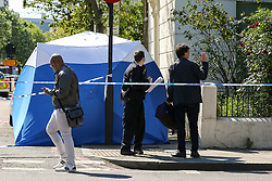 © Licensed to London News Pictures. 12/05/2019. London, UK. A forensics tent on Tollington Road, Islington in north London as Met police launch an investigation into the death of a man who was found in a wheelie bin behind a Waitrose store shortly before 4pm on Saturday 11 May 2019. Photo credit: Dinendra Haria/LNP