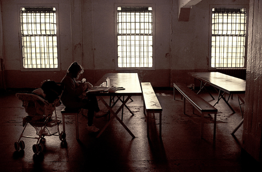 During a tour of the historical Alcatraz Penitentiary a mother feeds her baby in the old dining hall