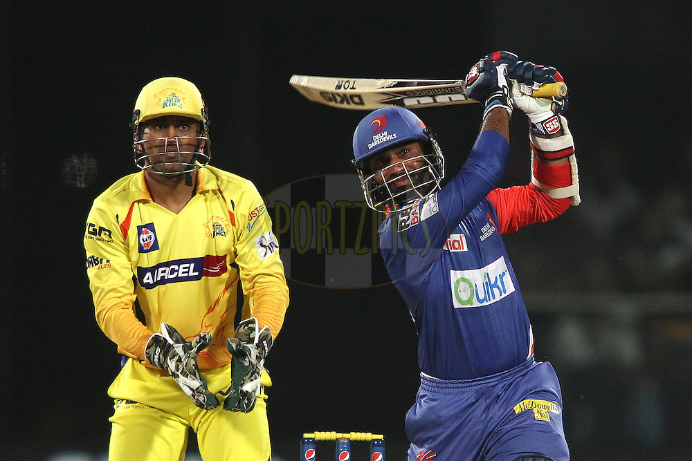 Dinesh Karthik of the Delhi Daredevils hits over the top for a boundary during match 26 of the Pepsi Indian Premier League Season 2014 between the Delhi Daredevils and the Chennai Super Kings held at the Feroze Shah Kotla cricket stadium, Delhi, India on the 5th May  2014<br /> <br /> Photo by Shaun Roy / IPL / SPORTZPICS<br /> <br /> <br /> <br /> Image use subject to terms and conditions which can be found here:  http://sportzpics.photoshelter.com/gallery/Pepsi-IPL-Image-terms-and-conditions/G00004VW1IVJ.gB0/C0000TScjhBM6ikg