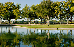 Man running beside the pond at Storey Park in Houston, Texas