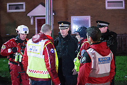 © Licensed to London News Pictures . 26/12/2015 . Salford , UK . Temporary Assistant Chief Constable John O'Hare (centre) at the scene . Mountain rescue , police and fire crews on Lower Broughton Road as residents were evacuated from surrounding streets following flooding . Photo credit : Joel Goodman/LNP