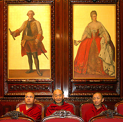 BRUSSELS, BELGIUM - JUNE-01-2006 - Buddhist Monks traveling with the Dalai Lama's delegation during his five-day visit to Belgium, sit in the Belgian Parliament waiting for the Dalai Lama to address members of parliament. (PHOTO © JOCK FISTICK)