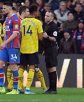 Football - 2019 / 2020 Premier League - Crystal Palace vs. Arsenal<br /> <br /> Referee,Paul Tierney reverses his decision from a yellow card to a red for Pierre - Emerick Aubameyang after reviewing the VAR at Selhurst Park.<br /> <br /> COLORSPORT/ANDREW COWIE